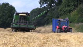 A combine Harvester at work in a barley field in Ireland.Video by Robin Wallace http://www.celticvideo.com