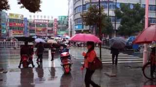 Changde China  city images : People crossing the street in Changde in the rain