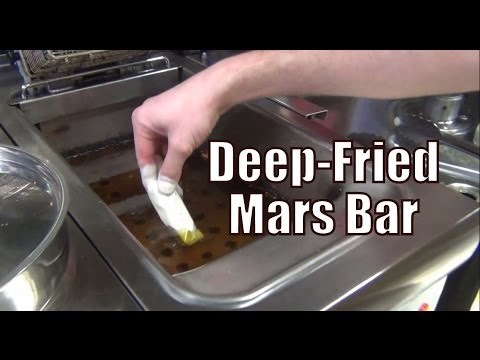 Eating a deep-fried Mars Bar in Edinburgh, Scotland