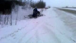 8. arctic cat mountain cat 800 playing in the ditch