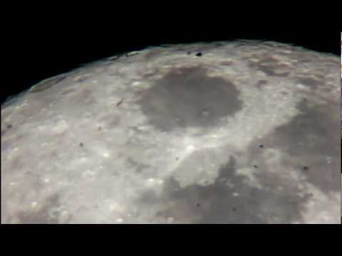 UFO Space Craft Flying Across the Full Moon Surface