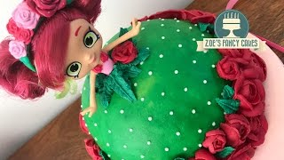 How to make a Shopkins Shoppies doll cake using a Rosie Bloom doll. This is my first buttercream tutorial as I usually use fondant for my cakes, so let me know which you guys prefer! I also usually make my own dolls using gum paste, but I decided to give this method a go using a Rosie Bloom doll I got from the shop. You can use any of the other characters in the same way from the Shopkins Shoppies series :)Tools and products used in this video - Craft mat - http://amzn.to/2dMKpl9 Fuchsia pink - http://amzn.to/2prXIPwApple green sugarflair - http://amzn.to/2oDr0FLLeaf piping nozzle - http://amzn.to/2q6vKEXMedium petal nozzle - http://amzn.to/2oDqojLSmall petal nozzle - http://amzn.to/2q6o5XgFlower nail - http://amzn.to/2psfSADRoyal icing - http://amzn.to/2oCzsGjCake cloth - http://amzn.to/2p95875Basic Victoria sponge cake recipe - Ingredients: 225g butter225g caster sugar4 eggs225g self-raising flour 1 tsp vanilla essenceMethod:Cream together the butter and sugar, then beat in the eggs and vanilla essence. Once smooth and creamy, fold in the flour.Pour in to a greased cake tin and bake in the oven at 180degrees for approximately 40 minutes, until golden brown and a knife comes out clean.Buttercream recipe - 600g icing sugar, sifted300g unsalted or salted butter, softenedoptional flavouringBeat the ingredients together.To see more of my cakes and creations please visit my pages below-Facebook https://www.facebook.com/zoesfancycakes Twitter https://twitter.com/zoesfancycakesInstagram https://instagram.com/zoesfancycakes/Website http://www.zoesfancycakes.co.uk/You can also check out my online courses with 25% off below! :)Faces - https://www.udemy.com/how-to-make-sugar-craft-faces/?couponCode=YT25OFFRoses - https://www.udemy.com/how-to-make-sugar-craft-roses/?couponCode=YT25OFF