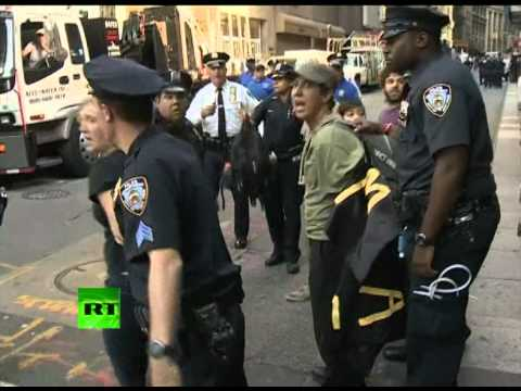 ows - Hundreds of police barricaded the New York Stock Exchange as Occupy Wall Street protesters swarmed the Financial District for the movement's one-year anniver...