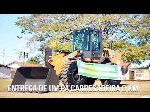 ENTREGA DOS UNIFORMES FUNCIONÁRIOS E PÁ CARREGADEIRA