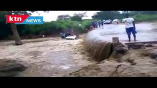 Tragedy: Car washed away by raging floods as the driver tries to cross flooded bridge