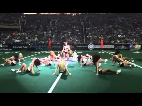 Arena football player joins the dance team for a half-time performance…..IN UNIFORM!!