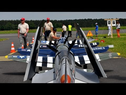 warbirds - Corsair F4U-F and P-47 Thunderbolt formation flight. Five pilots from three different countries flying together for the very first time at the AIRMEET 2012 i...
