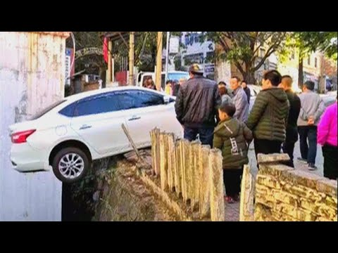 Car Teeters on Ledge After Accident