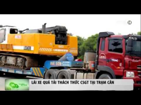 Lái xe quá tải thách thức CSGT tại trạm cân