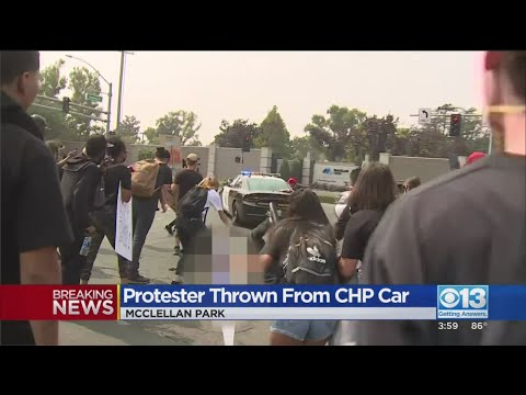 VIDEO: Trump Protester Seen Climbing On CHP Vehicle, Falling To Ground As It Takes Off