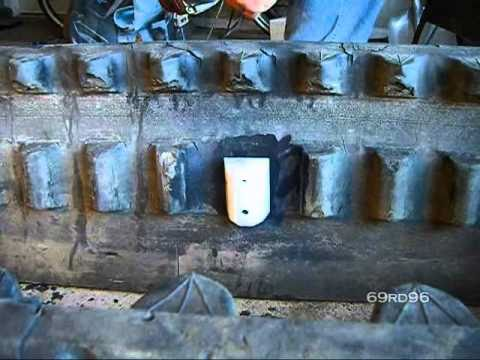 intallation - Installation of Larry Lugs from Bair Products on a rubber track from a Cat 247B2 MTL skid steer.