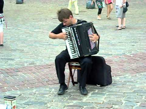 Awesome street artist playing Vivaldi on accordion.