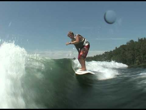 Jeff riding behind a Centurion on Inland Surfer Red Woody board
