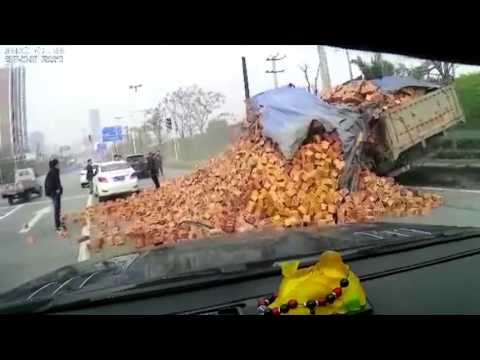 Horrific moment lorry sheds its load of BRICKS on a car