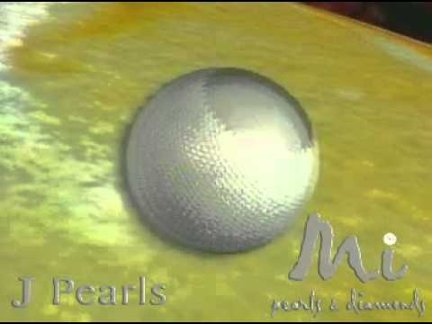 Pearl - http://www.jpearls.com Built from hexagonal aragonite crystals of calcium carbonate. Pearls are formed in Clams, Oysters and Mussels, and are found in many p...