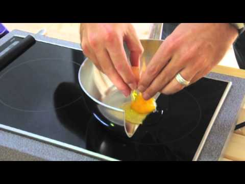 To Demonstrate How Induction Cooking Works A Chef Cooks Eggs Bacon and Chocolate on a Pan Cut in