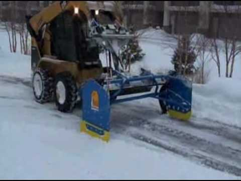 Snow Removal - The Kage snow removal system combines plowing and snow containment into one revolutionary new implement. It is for skid steers, loaders and tractors. In just...
