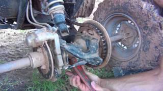 8. How to tighten a chain on a Polaris Scrambler 500 - Trail Boss 330