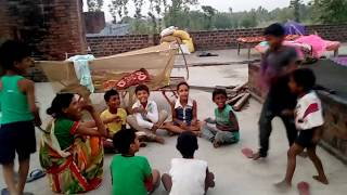 This is Funny Koda Game by children. They are enjoying on evening time on roof of house.
