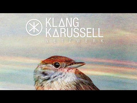 Tekst piosenki Klangkarussell - Symmetry po polsku
