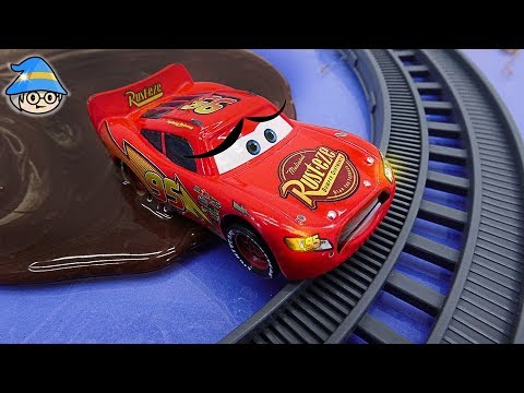 Lightning McQueen and Disney car Chicks Hicks cross the railroad tracks. Get out of the muddy road.