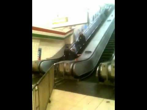 Drunk guy trying to walk up the escalator at Oxford Circus Underground - London