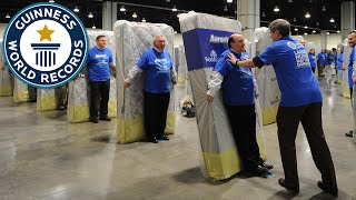 Video Largest human mattress dominoes - Guinness World Records MP3, 3GP, MP4, WEBM, AVI, FLV September 2017