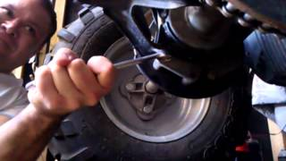 9. How to adjust tighten drive chain trail boss 330