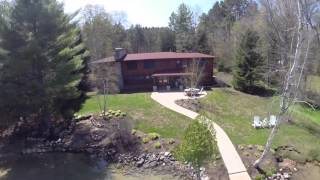 Large Walloon lakeside estate with patio dock and tennis court combines authentic log cabin charm with the luxury of a complete renovation. Top to bottom, this ...