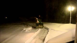 My beautiful transplanted wife enjoying doing battle with the elements with my (er...her) big John Deere Snow Blower.