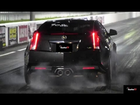 drag race - http://www.RoadTestTV.com A 2008 Shelby Mustang GT500 with pulley, tune, exhaust, and drag radials takes on our bone stock 2013 Cadillac CTS-V Coupe. The CTS...