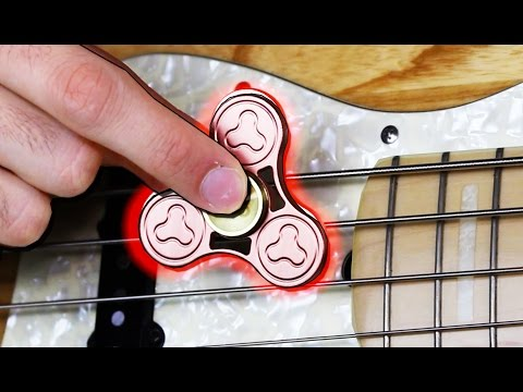Musician Plays Bass With a Whirling Fidget