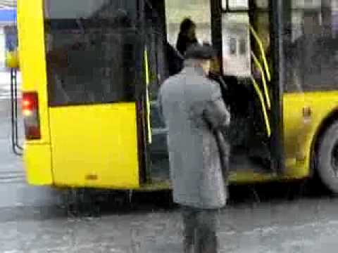 Crazy old man threatens a bus with a machine gun