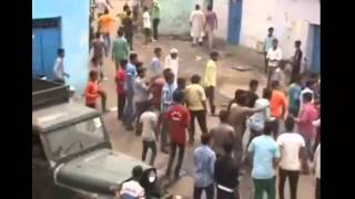 Dhanbad India  city images : Open Live Firing Outside a Polling Booth in Dhanbad, India
