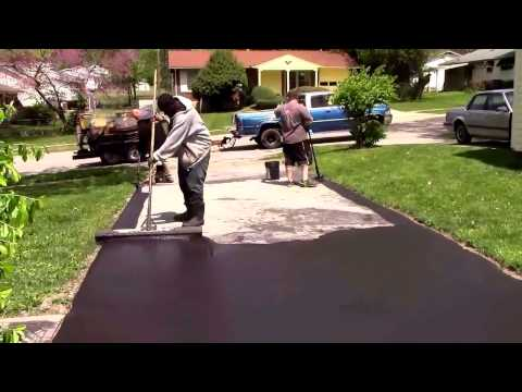 Oddly satisfying video of a driveway being sealed