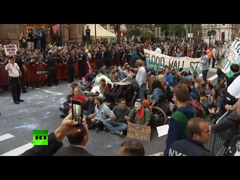 Street - Police have pepper sprayed Flood Wall Street protesters taking part in a massive rally against climate change - already into its second day in the heart of NYC's 's financial district. A...