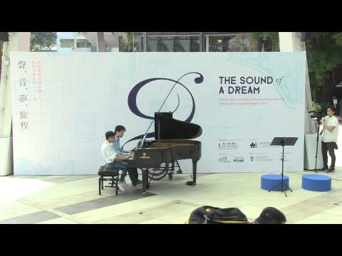 "This is Tang Cheuk Him's artwork - Tang Cheuk Him and his mentor Mr Alan Chu at ""The Sound of a Dream"", Artist with Disability Development Scheme – Community Inclusion Event 2015 Piazzolla – ""Libertango"""