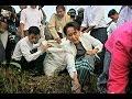 Suu Kyi takes out the trash
