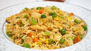 Serves: 2 - 3 peopleIngredients List:1 Chicken breast - Approx. 3/4th lb1 Tbsp minced garlic1/2 cup chopped onion1 Egg1/2 cup Mixed vegetables (frozen vegetables)2 cups cooked rice - preferably a day old and cold 1 Tsp Chicken stock powder (optional)1 Tbsp Soy sauce1 Tbsp Green chili sauce1 Tbsp Chilli garlic sauceSalt and pepper to tasteGreen onion for garnishEnjoy!~AMusic: iMovie JinglesFTC: This video is not sponsored