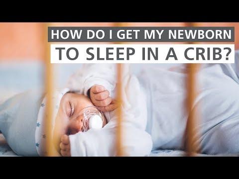 How do I get my newborn to sleep in a crib?