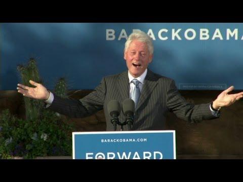 Clinton leads rally, mocks Romney