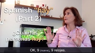 """Download FREE eBook → http://www.practiquemos.com/newsSoftware to practice (PC-Mac) → http://www.practiquemos.com/espanolFollow me:facebook → http://www.facebook.com/PRACTIQUEMOSGoogle+ → http://google.com/+PractiquemosEspanolTwitter → @practiquemosFREE SPANISH LESSONS - by Catalina Moreno EscobarLearn and practice Spanish with these free online Spanish lessons:""""haber"""" verbo impersonal para expresar """"existencia""""HAY + NÚMERO + SUSTANTIVO  (Parte 2)""""Hay"""" o """"no hay"""" se puede usar cuando se indica la cantidad exacta. Es un uso muy común del verbo """"haber"""" en español.  Ejemplos del uso de """"hay"""" para indicar una cantidad exacta:HAY + NÚMERO + SUSTANTIVO¿Cuántos euros hay aquí?Hay 140 euros.¿Cuánto dinero hay aquí?Hay 53 dólares.¿Cuántas cajas hay aquí?Hay 4 cajas.En la primera caja hay 4 libros.En la segunda caja hay 7 camisas.En la tercera caja hay 6 platos.En la cuarta caja hay 8 botellas:  hay 6 seis botellas de aceite de oliva y 2 botellas de vinagre.Otros ejemplos:————————————————En Barcelona hay 11 líneas de metro.¿Cuántos peces hay en este acuario?Hay 7 peces.Hay 2 personas en la sala de espera.El aparcamiento está vacío, solo hay 1 coche.Hay 5 vuelos cancelados.Hay 2 sillas libres.—————————————RECUERDA—————————————  Hay + número + sustantivo✓ hay 53 dólares✓ hay 7 camisas✓ hay 11 líneas de metroVocabulario:euros, dólares, camisas, platos, aceite de oliva, vinagre, acuario, peces, personas, aparcamiento, sala de espera, caja, silla, vuelo, dinero."""