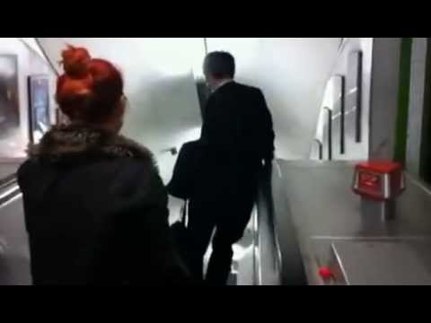 Businessman Tries To Go Down The Up Escalator Video