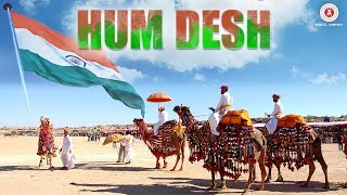 Presenting the official music video of Hum Desh sung by Tarlochan Singh (Tochi Raina), Zubin Sinha, Munawwar Ali, Vikaas Vishwakarma (Vikas Malviya), Mohd. Ramzan, Keval Jayawant Walanj, Mangal Mishra, Yashpal Singh (Yash Wadali) & Keshav Tyohar.Song: Hum DeshAlbum: Hum DeshSingers: Tarlochan Singh (Tochi Raina), Zubin Sinha, Munawwar Ali, Vikaas Vishwakarma (Vikas Malviya), Mohd. Ramzan, Keval Jayawant Walanj, Mangal Mishra, Yashpal Singh (Yash Wadali) & Keshav TyoharMusic: Zubin SinhaLyricist: Shatrunjay MishraArranger/Programmer: Vikaas Vishwakarma (Vikas Malviya)Pakhawaj & Tabla: Pt. Bhawani ShankarRabab: Chintoo SinghFlute: TejasGuitar: Bhupesh SurtiDholak: Taahir Hussain & Liyaqat HussainCast: Mohit Parmar, Meet Kapoor, Vicky Yadav, Lalan PahalwanAlpesh Darji, Rudraksh Darji, Kavya Shah, Mansi Jani & Priyanka JobanputraProduction House: Ayodhya ArtsProducer: Robin Sinha Director: Deepak PandeyMusic on Zee Music CompanyConnect with us on :Twitter - https://www.twitter.com/ZeeMusicCompanyFacebook - https://www.facebook.com/zeemusiccompanyYouTube - http://bit.ly/TYZMC
