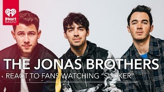 The Jonas Brothers React To Fans Watching