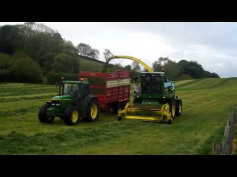 6920, 6910s 6910 and a massey 5470 with herron silage trailers