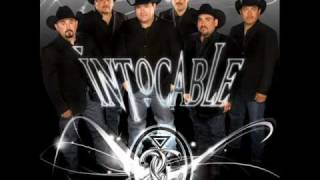 video y letra de Por un beso por Intocable