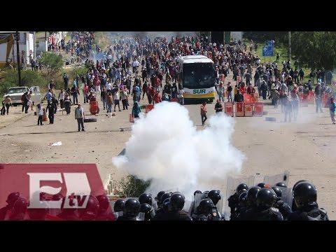 ¿Civiles armados durante enfrentamiento entre Policías y maestros?