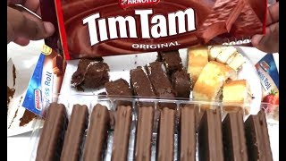 Snakinworld unwrapping and trying the Arnotts tim tam original biscuits all the way from Australia and swiss roll by the brand americana quality strawberry flavour and chocolate flavour.