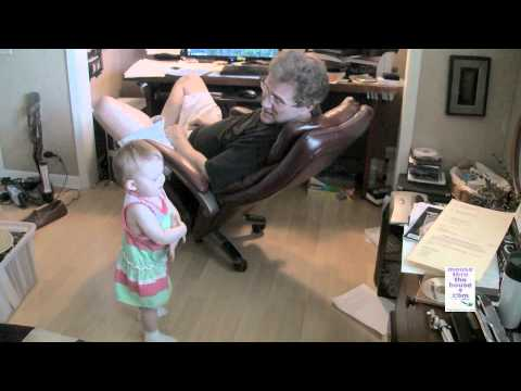 Granddad talking in fluent baby with baby